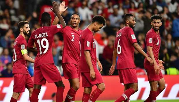 Qatar's forward Almoez Ali (L) high-fives with Qatar's defender Pedro Miguel Correia as they celebra