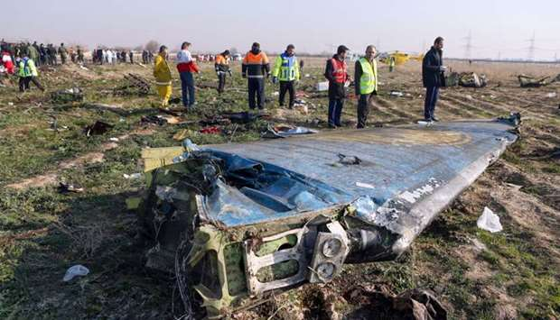 Rescue teams are seen at the scene of a Ukrainian airliner that crashed shortly after take-off near