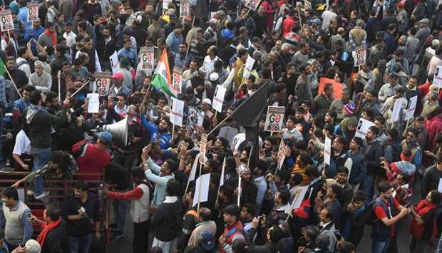 Protesters hold placards and shout slogans against Inida's Prime Minsiter Narendra Modi as they part