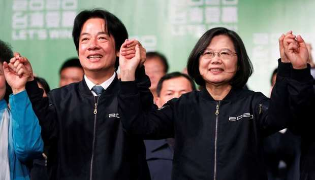 Taiwan Vice President-elect William Lai and incumbent Taiwan President Tsai Ing-wen celebrate at a r