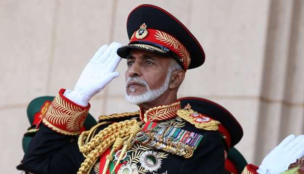 Oman's Sultan Qaboos bin Said salutes at the start of a military parade at a stadium in Muscat on th