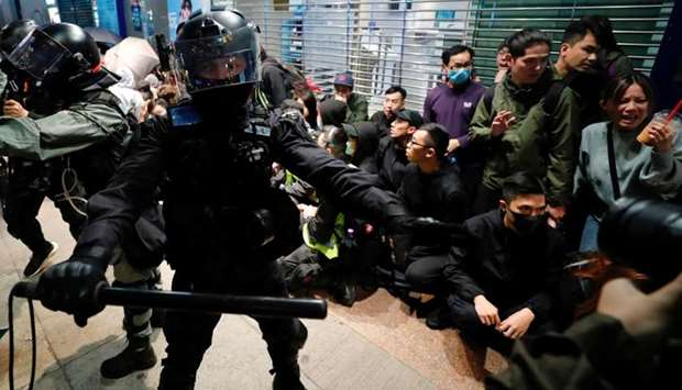 Riot police detain anti-government protesters in a large scale during a legal demonstration on the N