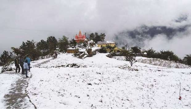 Tehri in Uttarakhand is covered in a thick blanket of snow yesterday.