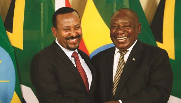 South African President Cyril Ramaphosa and Prime Minister of Ethiopia Abiy Ahmed shake hands after