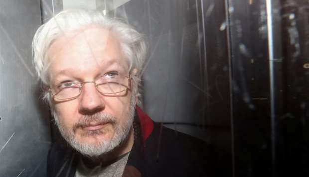 WikiLeaks' founder Julian Assange leaves Westminster Magistrates Court in London, Britain
