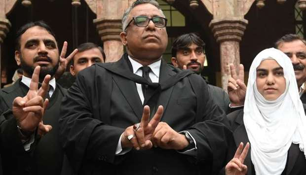 Azhar Siddique, the lawyer of former military ruler Pervez Musharraf, gestures alongwith team member
