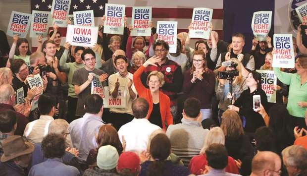 Democratic presidential candidate Senator Elizabeth Warren waves to supporters during a campaign sto