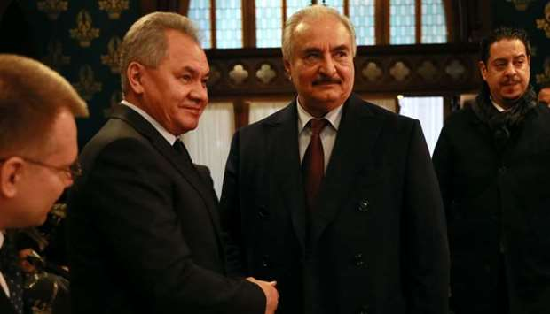 Russian Defence Minister Sergei Shoigu shaking hands with Libya's Khalifa Haftar in Moscow.