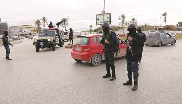 Central security support forces carry weapons during the security deployment in the Tajura neighbour