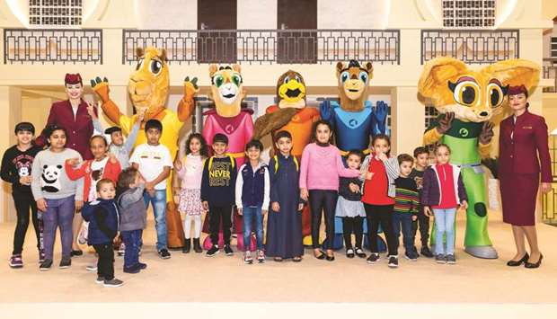 Qatar Airways' cabin crew with Oryx Kids Club mascots, Orry, Orah and friends, and children at the e