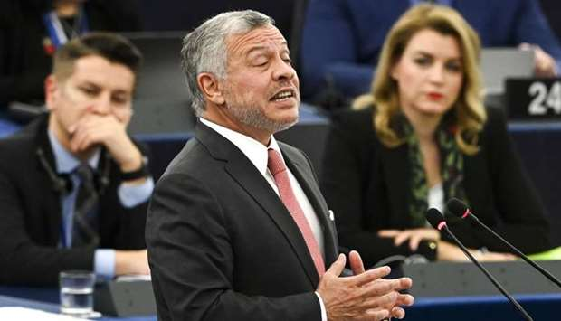 Jordanian King Abdullah II gestures as he delivers a speech at the European Parliament, on January 1