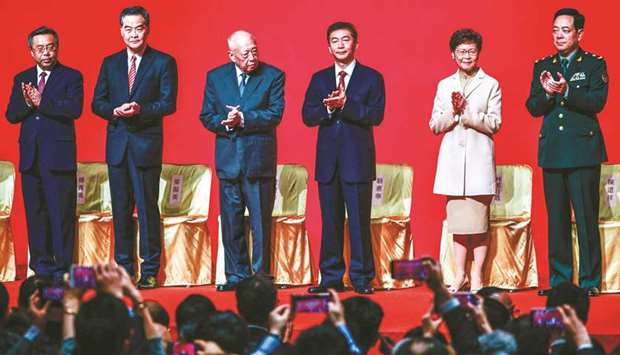 Chief Executive of Hong Kong, Carrie Lam (second right), stands on stage with other dignitaries at t