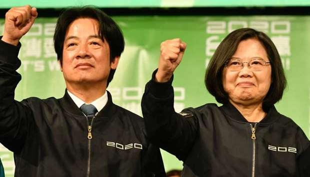 Taiwan President Tsai Ing-wen (R) and Vice President-elect William Lai (L) gesture outside the campa