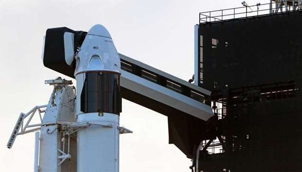 The SpaceX Crew Dragon sits atop a Falcon 9 booster rocket on Pad 39A at Kennedy Space Center before