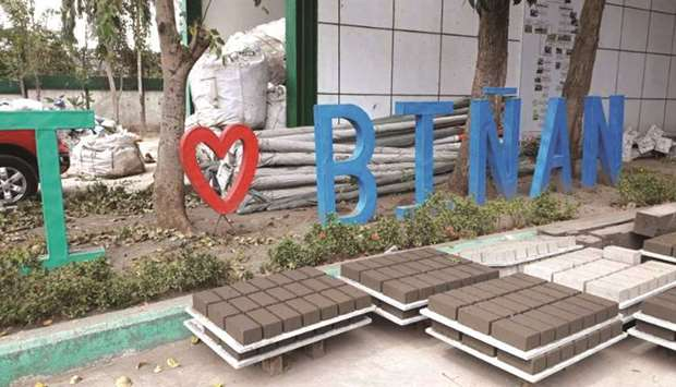 Bricks made of volcanic ash are laid out outside a brick-making facility in Binan, Laguna.