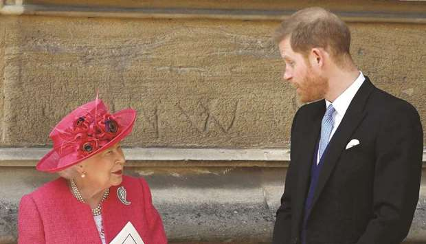 This file photo taken on May 18, 2019 shows Queen Elizabeth and Harry at St George's Chapel in Winds
