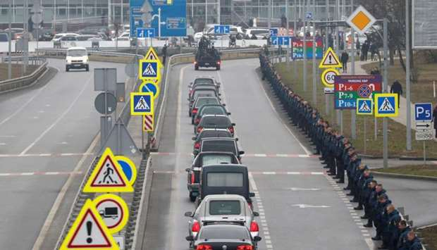A motorcade of hearses carrying the bodies of the eleven Ukrainian victims of the Ukraine Internatio