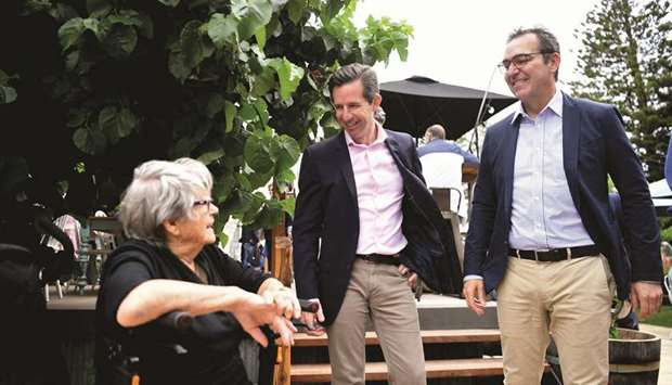 Australia's Tourism Minister Simon Birmingham (centre) and South Australia's Premier Stephen Marshal