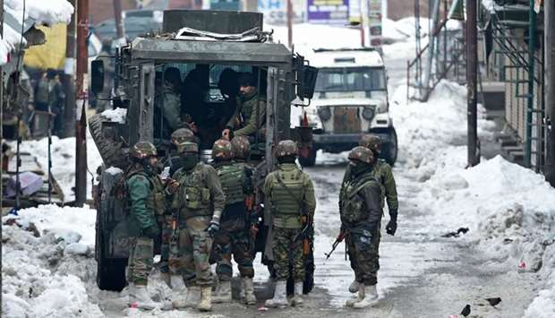 Indian army soldiers stand guard during a cordon and search operation following reports of the prese