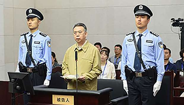 Former Interpol chief Meng Hongwei (C) during his trial at the court in the Chinese city of Tianjin