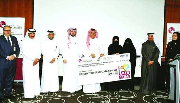 Qatar Chamber officials hand over the ceremonial cheque to the winners in the presence of other dign