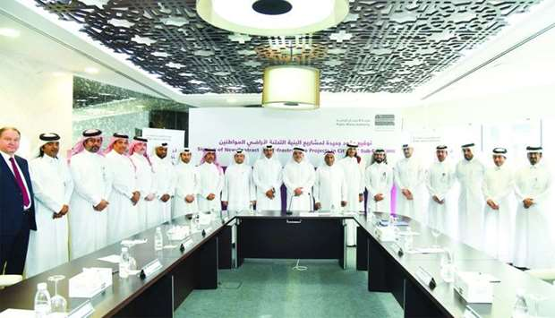 Ashghal officials with representatives of various contracting companies and CMC members at the signi