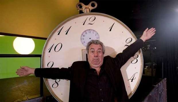 "Former Monty Python star Jones gestures in front of ""time machine"""