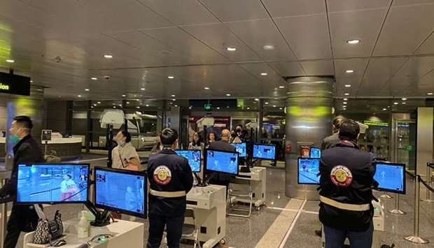 Passengers are being monitored at a thermal inspection site at Hamad International Airport