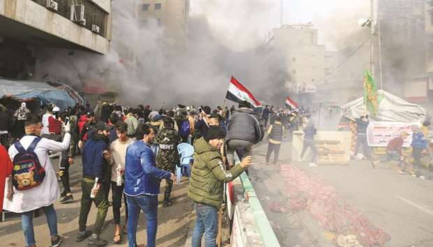 Four killed as Iraqi security forces raid protest camps