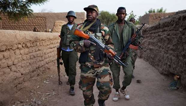 Malian soldiers patrol in the village of Kadji March 1, 2013