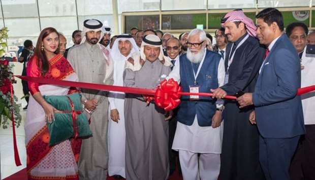 "Al-Khater, Sheikh Faisal and Rahman leading the ribbon-cutting ceremony of the ""Made in Bangladesh"""