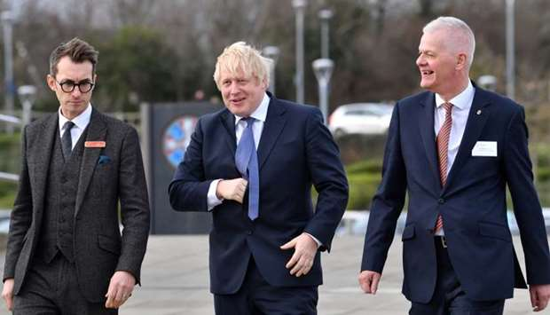 Britain's Prime Minister Boris Johnson arrives to attend a cabinet meeting held at the National Glas