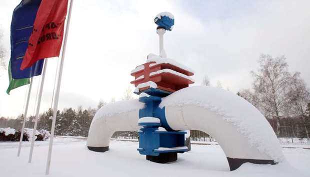 A model of a pipe line is seen at the main entrance to the Gomel Transneft oil pumping station, whic