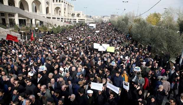 Demonstrators attend a protest against the assassination of the Iranian Major-General Qassem Soleima
