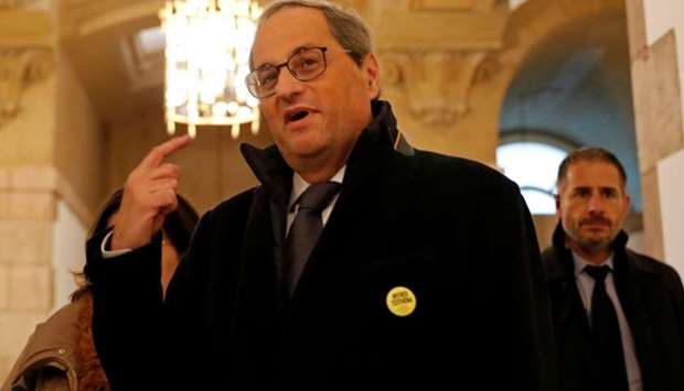 Leader of Catalonia's regional government Quim Torra arrives at the Catalan Parliament, ahead of an