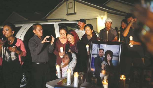 A candlelight vigil being held in Fresno to honour Kou Xiong, who was one of four killed in a mass s