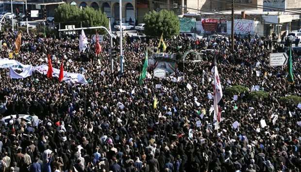 People attend a funeral procession for Iranian Major-General Qassem Soleimani, head of the elite Qud