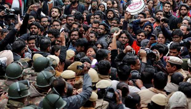 Demonstrators attend a protest against the attacks on students of Jawaharlal Nehru University (JNU)