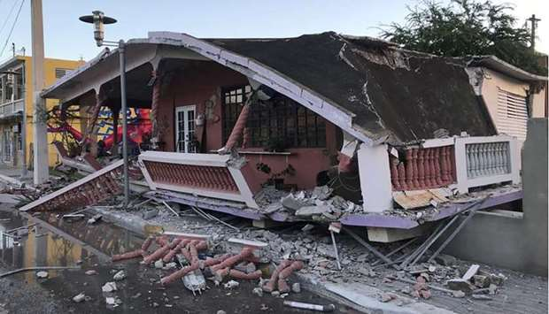 A home is seen collapsed after an earthquake in Guanica, Puerto Rico