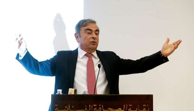 Former Nissan chairman Carlos Ghosn gestures as he speaks during a news conference at the Lebanese P