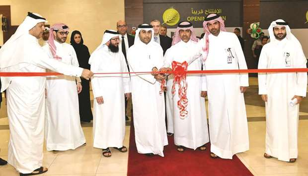 Al Meera officials and government executives lead the ribbon-cutting ceremony of the Rawdat Al Hamam