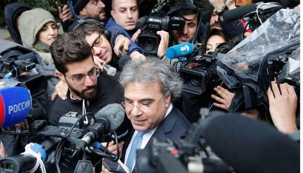 The lawyer of former Nissan chairman Carlos Ghosn speaks to the media after Ghosn's questioning, out