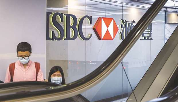 Customers use an escalator at the HSBC Holdings headquarters building in Hong Kong. ShareAction said