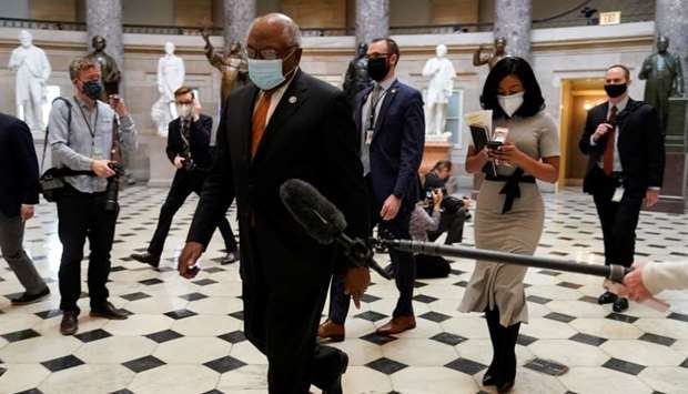 House Majority Whip James Clyburn walks to the House Chamber as Democrats debate one article of impe