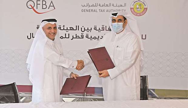 From left: QFBA CEO Dr Khalid Mohamed al-Horr and GTA president Ahmed bin Issa al-Mohannadi shaking