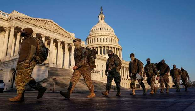 Members of the National Guard arrive at the US Capitol as Democratic members of the House prepare an
