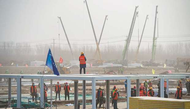 Workers at the construction site of the centralised medical observation centre, a makeshift facility
