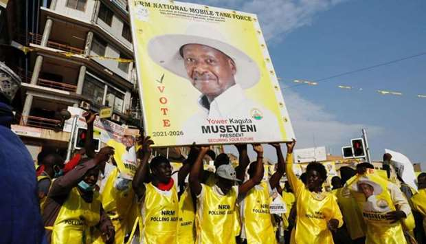 Polling agents from the National Resistance Movement (NRM) party celebrate the victory of Uganda's P