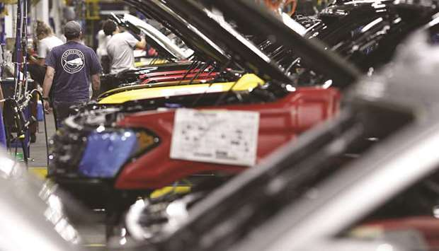 Employees working at an assembly line at the Ford truck plant in Louisville, Kentucky. The American