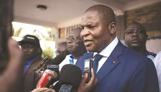 Incumbent Central African Republic president President Faustin-Archange Touadera, speaks to reporter